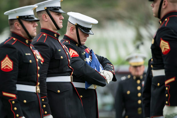 Marines from the Marine Barracks, Washington, D.C  fold the American flag during the full honors funeral of U.S. Marine Corps Col. Wesley Fox in Section 55 of Arlington National Cemetery, Arlington, Virginia, April 17, 2018. (U.S. Army/Elizabeth Fraser)