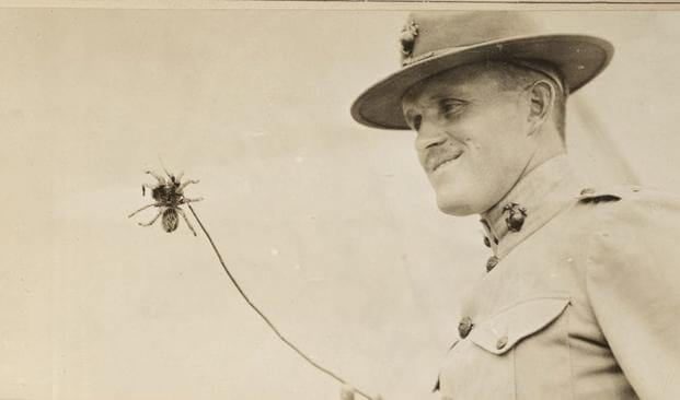 A U.S. Marine at Marine Corps Training Activity San Juan, Cuba, shows off the tarantula he found. Tarantulas commonly crawled into the Marines' boots at night. (Photo: National Archives and Records Administration)