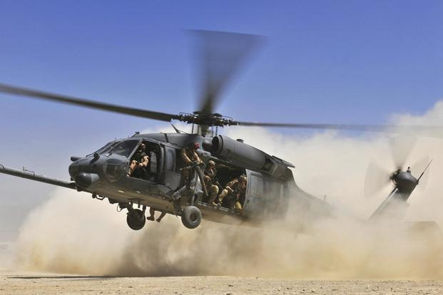 An HH-60G Pave Hawk helicopter carrying combat search and rescue Airmen approaches a landing zone during an exercise at Bagram Airfield, Afghanistan, Aug. 21. 2010. (U.S. Air Force/Staff Sgt. Christopher Boitz)
