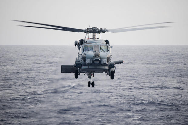 "An MH-60R Seahawk assigned to the ""Tropics"" of Helicopter Maritime Strike Squadron (HSM) 49.5 prepares to land on the flight deck of guided-missile destroyer USS Sterett (DDG 104) during the at-sea phase of the Rim of the Pacific (RIMPAC) exercise. (U.S. Navy photo/Alexander C. Kubitza)"
