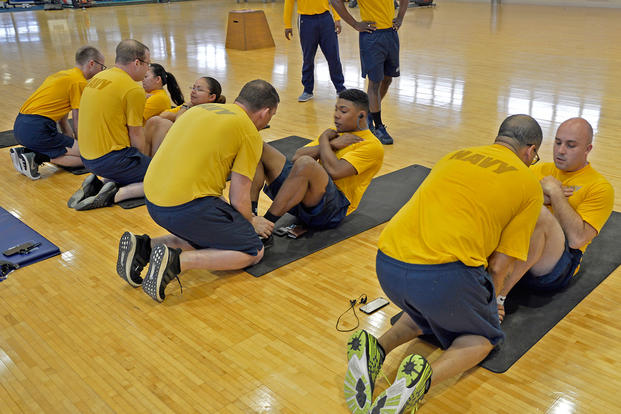 Sailors attached to the U.S. 7th Fleet flagship USS Blue Ridge (LCC19) participate in the Physical Fitness Assessment (PFA). (U.S. Navy photo/Dylan McKay)