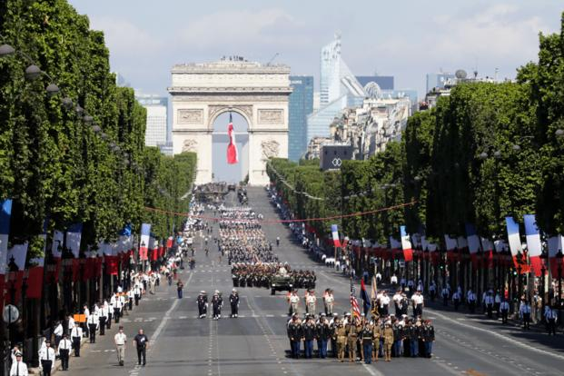U.S troops march down the Champs Elysees avenue, with the Arc de Triomphe in background, during the Bastille Day parade in Paris on July 14, 2017.  (AP/Photo/Markus Schreiber)