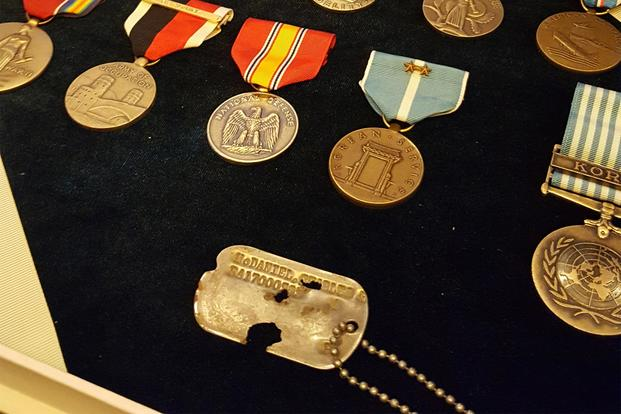 Army Master Sgt. Charles McDaniel's dog tag and service medals on display. (Military.com/Richard Sisk)