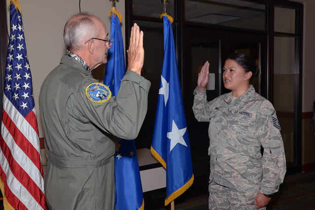 Retired Air Force Maj. Gen. Edward Mechenbier re-enlists his daughter, Master Sgt. Kari Eubanks, Air Force Reserve, 302nd Force Support Squadron, at Peterson Air Force Base, Colorado, Aug. 5, 2018. Mechenbier has re-enlisted Eubanks three times in her career and several others in this family over the years. (U.S. Air Force/Tiffany Lundberg)