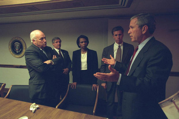 President George W. Bush talks with Vice President Dick Cheney, National Security Advisor Condoleezza Rice and other advisors during meetings at the President's Emergency Operations Center, Sept. 11, 2001. (National Archives)