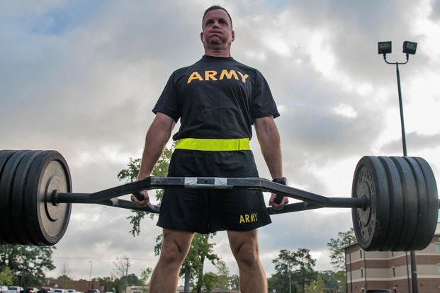 A TRADOC senior leader participates in the strength deadlift, during an exhibition of the new Army Combat Fitness Test Aug. 1, 2018 at Fort Eustis, Va. (U.S. Army photo/Tristan Biese)