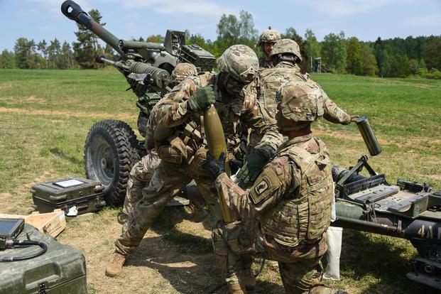 U.S. Army Paratroopers, assigned to Battery A, 4th Battalion, 319th Airborne Field Artillery Regiment, 173rd Airborne Brigade, load a round into a M119 105mm howitzer during an exercise at the Grafenwoehr Training Area, Germany, May 4, 2018. (U.S. Army/Markus Rauchenberger)