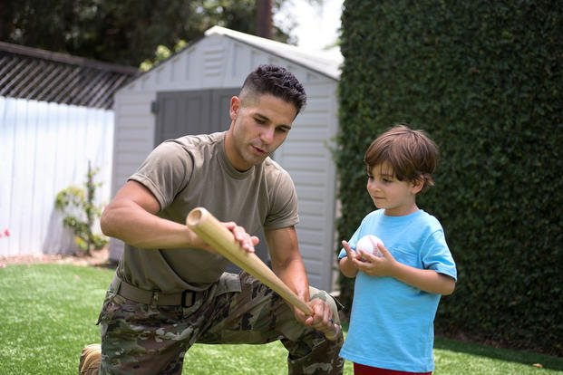 Soldier and son playing baseball
