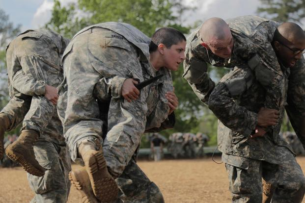 U.S. Army Capt. Kristen Griest, middle, carries a fellow Soldier as part of combative training during the Ranger Course on Ft. Benning, GA., April 20, 2015. (U.S. Army/Spc. Nikayla Shodeen)