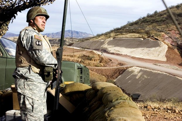 An Army National Guardsman assigned to an entry identification team watches the U.S./Mexico border near Nogales, Ariz. California Guard troops will remain at the Mexican border at least until the end of March. (US Army photo/jim Greenhill)