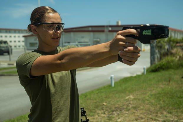 Lance Cpl. Brook Klahn, a combat engineer with Combat Logistics Battalion 31, aims a Taser during nonlethal weapons training at Camp Hansen, Okinawa, Japan, May 15, 2018. (U.S. Marine Corps photo/Alexis B. Betances)