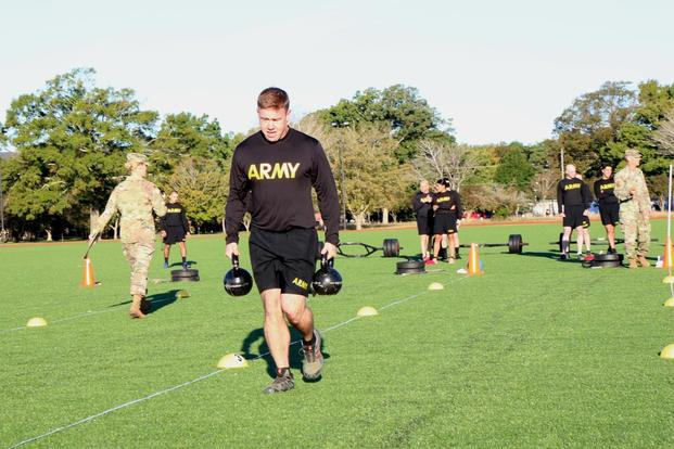 Staff Sgt. Brandon Powell demonstrates carrying two 40-pound kettle bells in the spring-drag-carry event on the Army Combat Fitness Test. (Military.com/Matthew Cox)