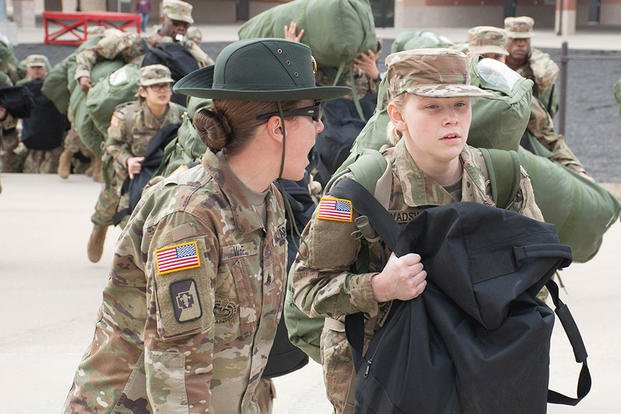 A U.S. Army drill sergeant corrects a recruit during her first day of training at Fort Leonard Wood, Mo., Jan. 31, 2017. (U.S. Army photo/Stephen Standifird)