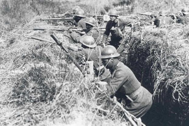 African-American soldiers (and one of their white officers) of the 369th Infantry, known as the Harlem Hellfighters, practice what they will soon experience, fighting in the trenches of the Western Front. They are wearing French helmets and using French-issued rifles and equipment, the logic being that since they were fighting under French command, it was easier to resupply them from the French system than trying to get American-issued items. (National Archives and Records Administration)