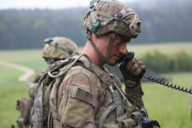 A soldier with 4th Battalion, 319th Field Artillery Regiment, 173rd Infantry Brigade Combat Team (Airborne), communicates over the radio during Saber Junction 18 at the U.S. Army's Joint Multinational Readiness Center in Hohenfels, Germany, on Sept. 23 , 2018. A new product might reduce troops' load by reducing the need for batteries. (U.S. Army photo by Spc. Dhy'Nysha Shaw)