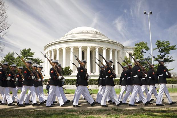 The Marine Corps Silent Drill Platoon marches in front of the Thomas Jefferson Memorial on their way to perform for the Cherry Blossom Festival in Washington D.C., April 13, 2014. (U.S. Marine Corps/Sgt. Bryan Nygaard)