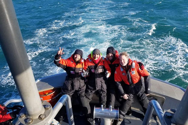 Four mariners are brought back to shore near Morehead City, North Carolina, aboard a 47-foot Coast Guard boat, after being rescued by the crew of the Coast Guard Cutter Escanaba, Nov. 28, 2018. Their sailboat was demasted more than 100 miles southeast of Cape Lookout, two days prior, and they used an EPIRB to broadcast their distress. (U.S. Coast Guard photo/Nicholas Healy)