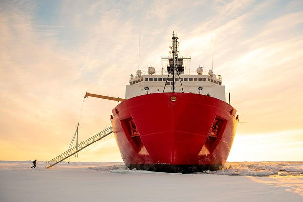 The U.S. Coast Guard cutter Healy sits in the ice about 715 miles north of Barrow, Alaska, Sept. 30, 2018, during an Arctic research mission. (Coast Guard photo by Senior Chief Petty Officer NyxoLyno Cangemi)