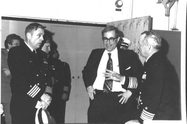April 1977: Secretary of Defense Harold Brown speaks with officers at the Naval Submarine Base in New London, Connecticut. (National Archives photo)
