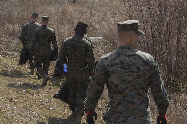 017f7e70 U.S. Marines with Combat Logistics Battalion 2, 2nd Marine Logistics Group,  pick up trash