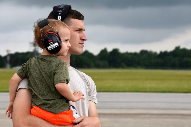 e342e90c1d106 A father holds his son on the flightine at the 179th Airlift Wing in  Mansfield