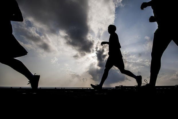 U.S. Marines and U.S. Navy Sailors with the 22nd Marine Expeditionary Unit (MEU) and USS Bataan (LHD 5) participate in a 5K run for a Navy and Marine Corps Relief Society autism awareness fundraiser aboard the Bataan. (Austin Hazard/Marine Corps)