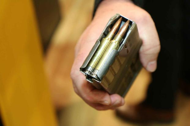 This is Sig Sauer's design for the Next Generation Squad Weapon's 6.8mm cartridge that features  a stainless steel base to save weight. (Military.com/Matthew Cox)
