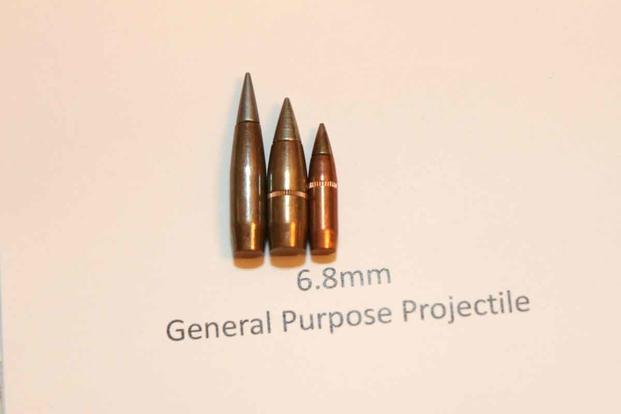 Army's 6.8mm General Purpose Projectile (Left) compared to the Army's current M80A1 Enhanced Performance Round (Center) and the M855A1 Enhanced Performance Round from an Army Futures Command event in mid-July. (Military.com/Matthew Cox)