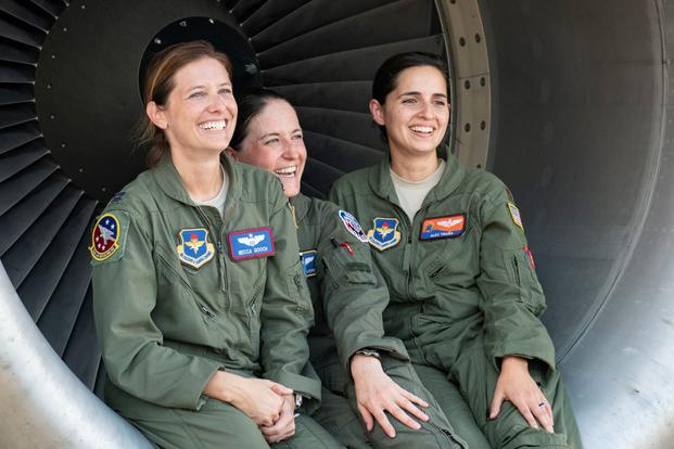 U.S. Air Force Capt. Rebecca Gooch (left), a KC-135 Stratotanker instructor pilot assigned to the 54th Air Refueling Squadron at Altus Air Force Base, Oklahoma, Master Sgt. Samantha Converse, a KC-135 instructor/evaluator boom operator assigned to the 54th ARS at Altus AFB, and Maj. Alexandra Traña, a KC-135 instructor pilot assigned to the 54th ARS at Altus AFB pose for a photo, Sept. 18, 2019, at the Alliance Airfield, Fort Worth, Texas. This year and for the first time, the Mighty 97th sent its own all-w