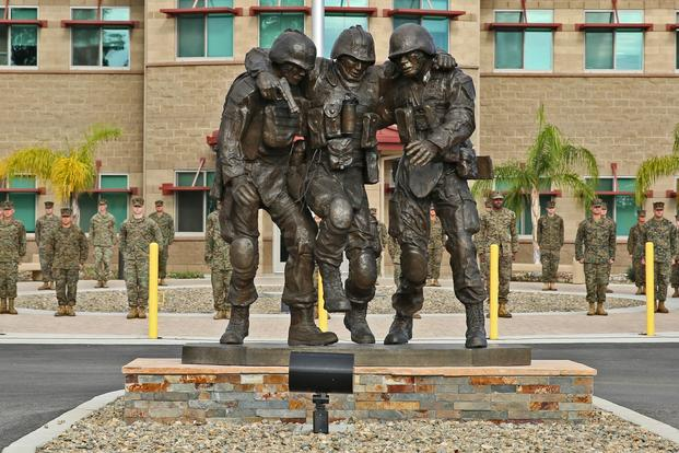 The Wounded Warrior Battalion-West held a ceremony Nov. 12, 2014, to unveil a monument honoring service members wounded during combat. The sculpture is based on the Operation Phantom Fury photograph 'Hell House' of then 1st Sgt. Bradley Kasal being carried out of a house by two lance corporals after a fire fight where Kasal sustained injuries. 'The monument is a symbol of camaraderie that's important to Marines, not only in combat but in the healing process as well, ' said Robin Kelleher, president of Hope