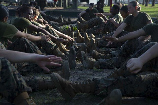 Recruits stretch between obstacles during the Confidence Course.