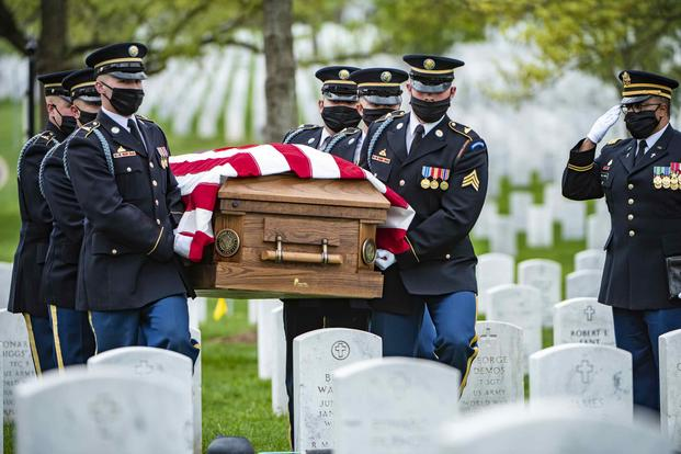 Soldiers conduct modified military funeral honors in Arlington National Cemetery.