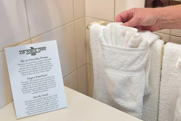 A housekeeper hangs clean towels at the General John K. Cannon Hotel.