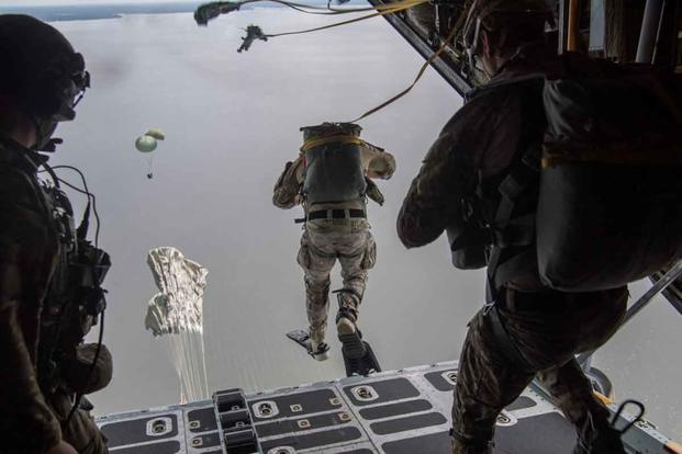 Air Force Special Tactics operators conduct a static line jump out of a C-130H.