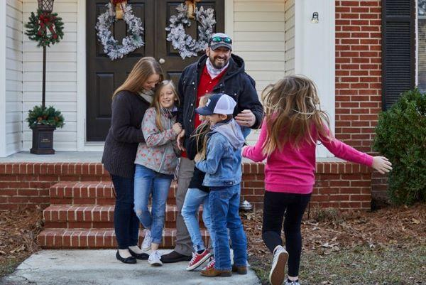 Purple Heart veteran Clint Myatt and his family accept the keys to their mortgage-free home.