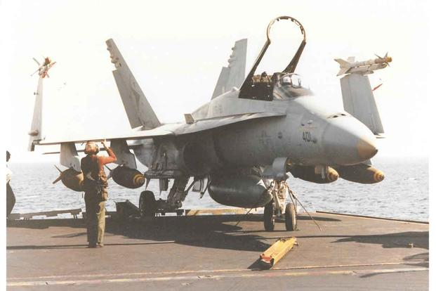 Fox's F/A-18 aboard the USS Saratoga before launching.
