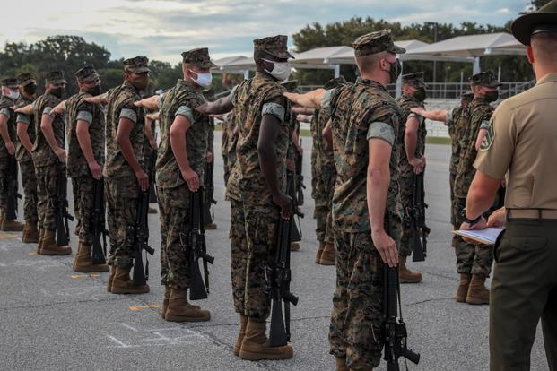 Marine Corps recruits execute a drill movement aboard Marine Corps Recruit Depot Parris Island.
