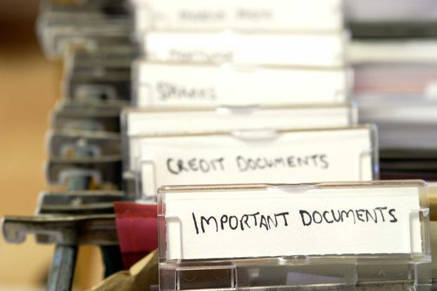 "Folder with tab labeled ""important documents"""