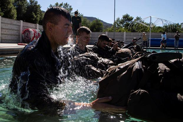 U.S. Marine Pfc. Benjamin Cameron jumps into the pool as part of the Infantry Marine Course.