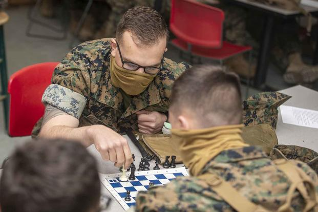 U.S. Marines play a game of chess.