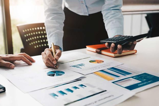 Financial planner with table full of charts and diagrams