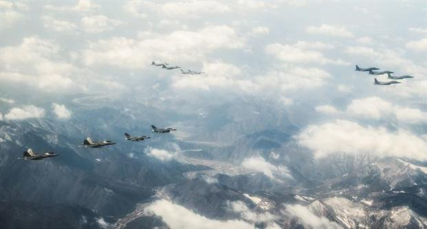 Four U.S. Air Force F-22 Raptors from Kadena Air Base, Japan, fly over the skies of South Korea on Feb. 17, 2016, in response to recent provocative action by North Korea. The Raptors were joined by South Korean F-15K Slam Eagles and U.S. Air Force F-16 Fighting Falcons. (Photo by Dillian Bamman/U.S. Air Force)