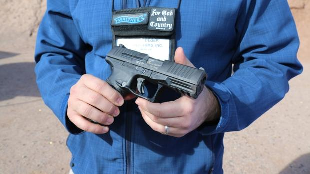 Everett Deger, marketing director for German gun-maker Walther, shows off the company's first-ever .45-caliber pistol, the PPQ 45, at range day as part of SHOT Show in Las Vegas, Jan. 18, 2016. (Photo by Brendan McGarry/Military.com.)