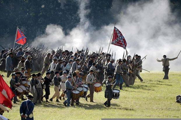 Confederate soldier re-enactors charge to battle during the 150th anniversary of Gettysburg in Gettysburg, Pa., July 6, 2013. (DOD/EJ Hersom)