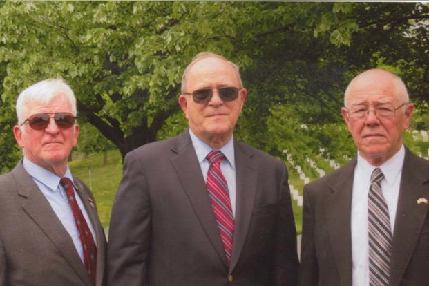 Bill Ivory, left, a classmate of Charles R. Trescott, John Ernst and Mike Rowan, vets of Gulf Company, 2nd Battalion, 5th Marines, gathered April 21, 2017, at Arlington Cemetery to commemorate Trescott's new gravestone. (Photo courtesy Bill Ivory)