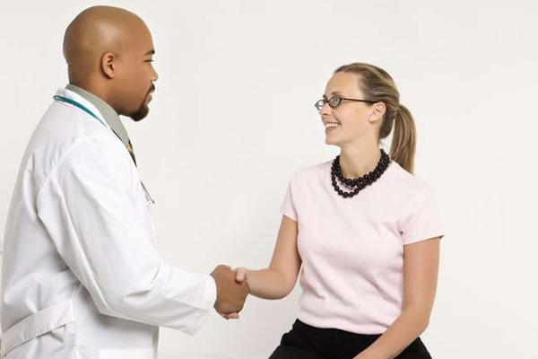 Doctor greets a patient with a handshake.