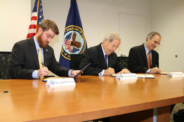 Representatives of SVA, VA, and NSC sign MOU to study GI Bill veteran records