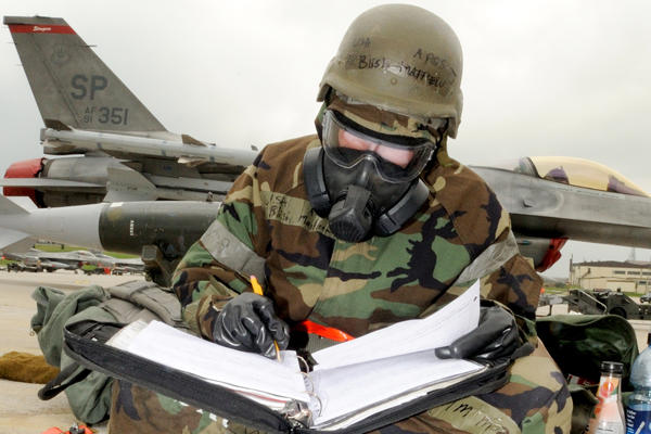 Airman sitting and studying.