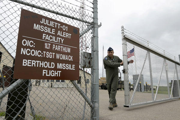 In this June 2014 file photo, Capt. Robby Modad closes the gate at an ICBM launch control facility in the countryside outside Minot, N.D., on the Minot Air Force Base. Charlie Riedel/AP
