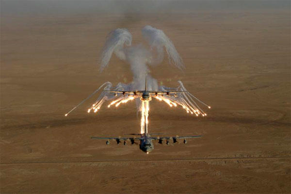 A KC-130 Hercules refueling aircraft fires flares used as countermeasures against surface-to-air missiles. The Chinese have just deployed such missiles on a disputed island, in response to US air and sea patrols. (DoD photo)